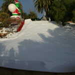 holiday snow party with man made slide